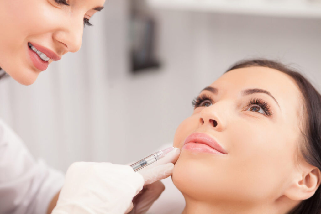 Woman receiving a botox® injection from a cosmetic specialist